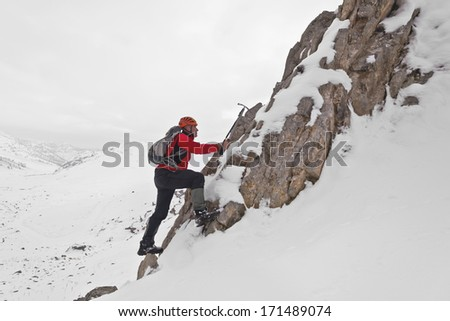 Climbing a mountain - stock photo