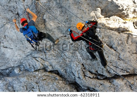 Climbing alpinists on Koenigsjodler route, Austria