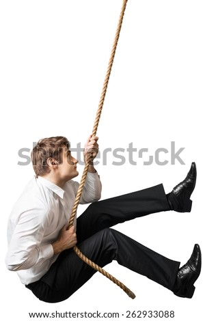 Climbing. Business man climbs a mountain  - stock photo