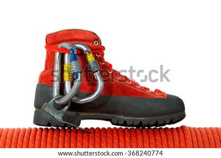 Climbing Equipment on White Background / Rock climbing equipment with mountaineering boot, two carabiners, a piton and a red rope. Isolated on white background - stock photo