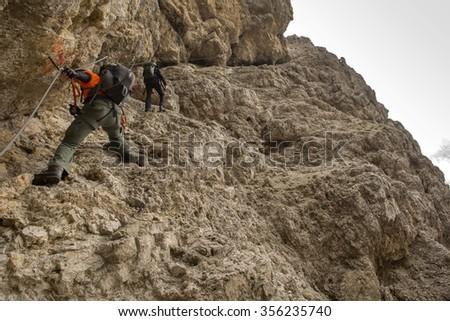 Climbing ferratas in the Dolomites. Alps, Italy. - stock photo