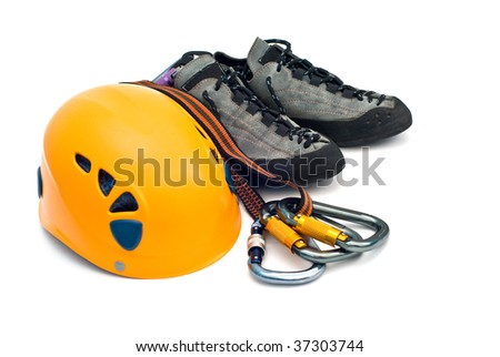 climbing gear - carabiners, orange helmet, rope, grey shoes - stock photo