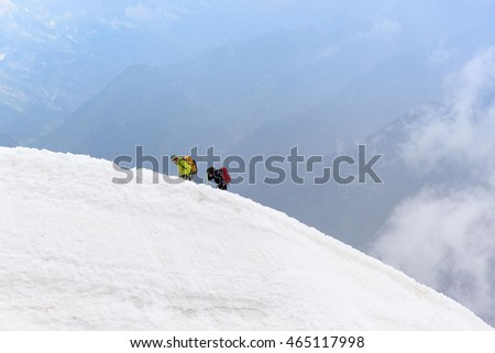 Climbing group walking on the top of snow slope of Mont Blanc, Chamonix, France, Europe