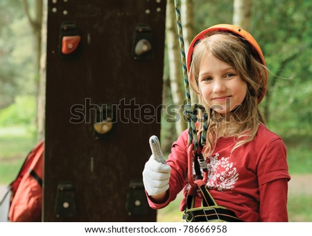 Climbing in forest - stock photo