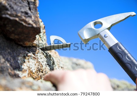climbing iron and climbing hammer with in the rock