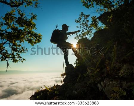 Climbing on the mist to mountain  - stock photo