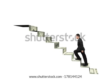 Climbing to top of money stairs isolated in white background - stock photo