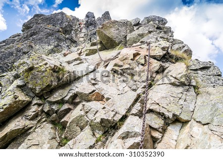 Climbing trail with chains in the Tatra mountains - stock photo
