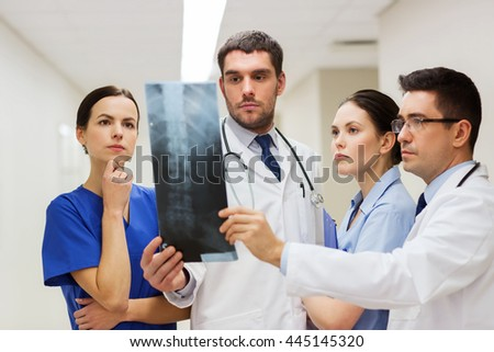 clinic, people, healthcare and medicine concept - group of medics with spine x-ray scan at hospital - stock photo