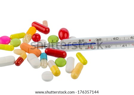 clinical thermometer and tablets, symbol photo for disease and medication - stock photo