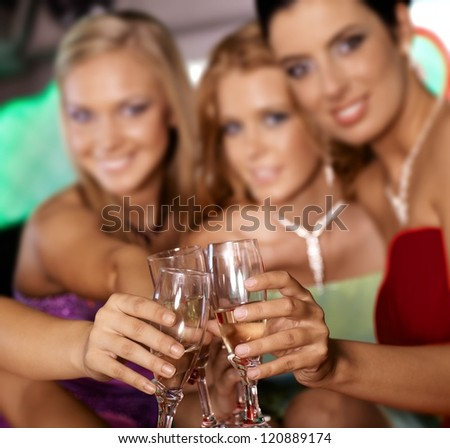 Clinking glasses, celebrating with champagne. - stock photo