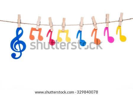 clip on a  twine , hanging colorful music symbol artist - stock photo