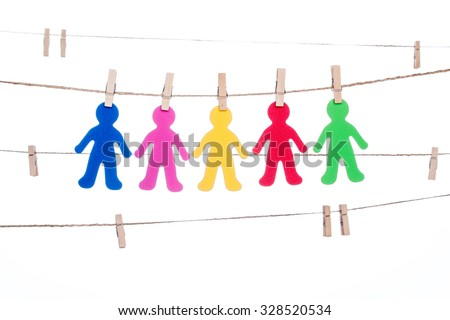 clip on a  twine , hanging colorful people  global  multiracial partnership togetherness - stock photo