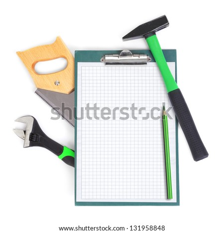 Clipboard and green tools, gentle natural shadow among objects - stock photo