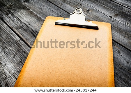 clipboard outdoors lying on a table - nice background with space for text