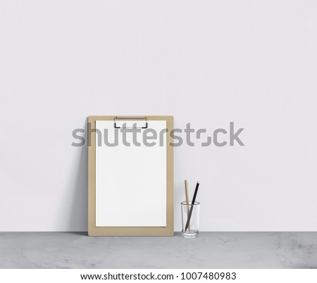 Clipboard with blank A4 letterhead and two pencils in glass, mockup for your project, 3d rendering