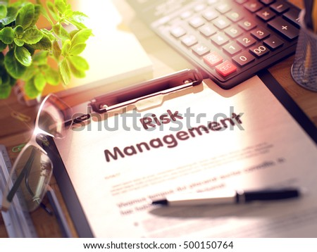 Clipboard with Concept - Risk Management with Office Supplies Around. 3d Rendering. Blurred Image.
