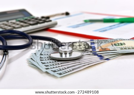clipboard with medical form and stethoscope on money - stock photo