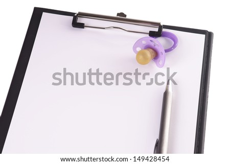 Clipboard with pen and pacifier / clipboard - stock photo