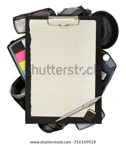 Clipboard with photographic equipment isolated on white background