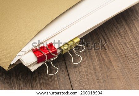 clipped papers.On desk. - stock photo