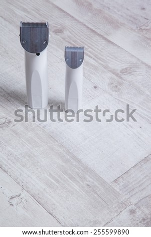 clippers barber professional tool for cutting, shot with depth of field on light textured background. - stock photo