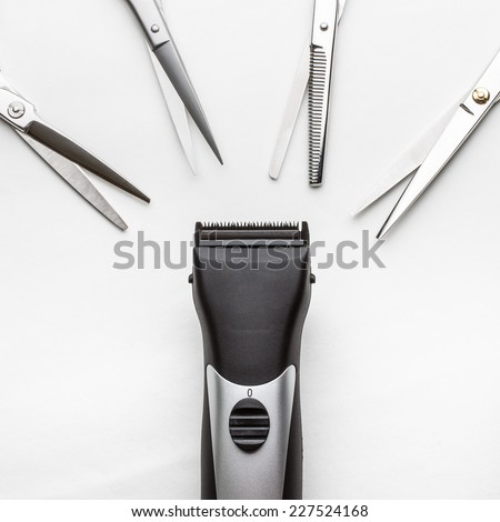clippers vs scissors on white background - stock photo