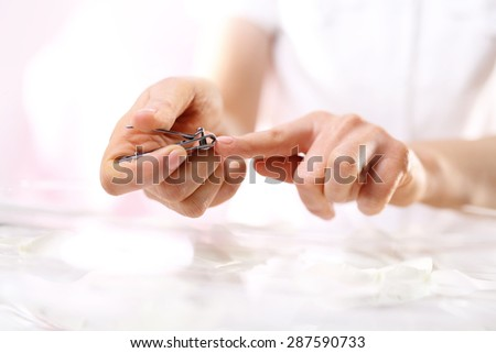 Clipping nails, hand care.The woman cuts the nails, manicure home