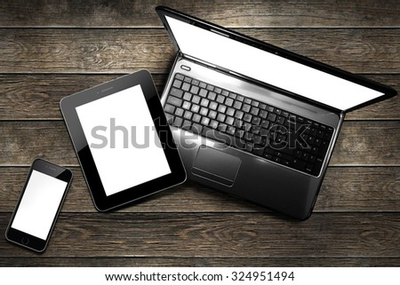 clipping path screen smartphone, tablet and laptop desk top - stock photo