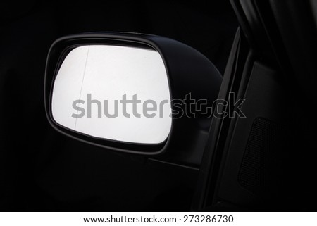 Cloae up of car mirror - stock photo