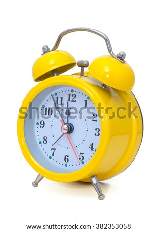 Clock. Alarm clock, in a yellow box,