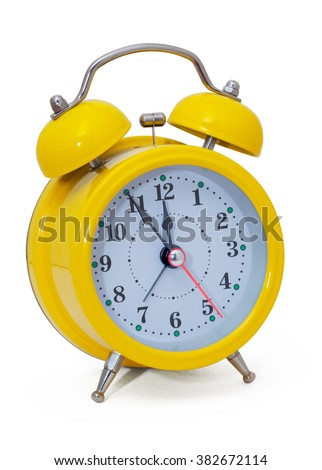 Clock. Alarm clock, in a yellow box, on a white background. Isolated