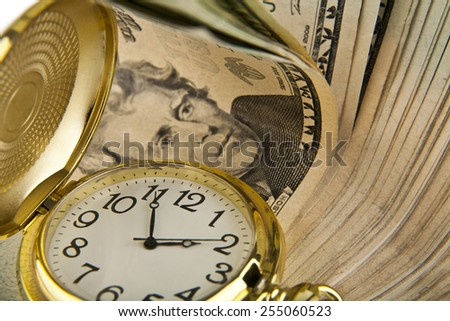 clock and dollars as a background