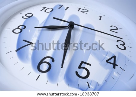 Clock and Fluorescent Light Bulb in Blue Tone