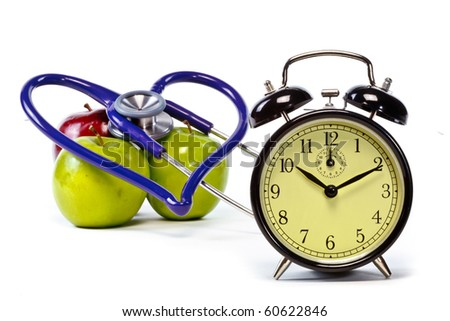 Clock and hearth shaped stethoscope with green and red apples