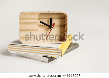 clock and Notebook.