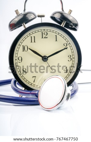 Clock and stethoscope with white background.