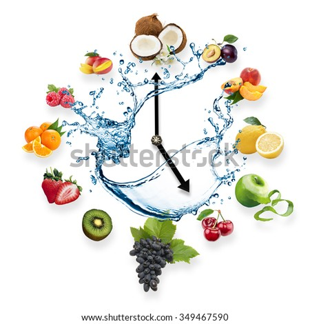 Clock arranged from healthy fruits splash by water isolated on white background. Food clock with fruits. Healthy food concept. - stock photo