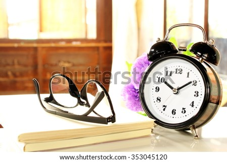 Clock bell on the table