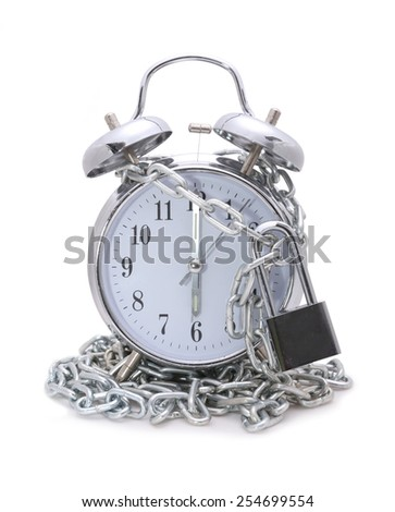 Clock bound with chain and padlock concept stop time - stock photo