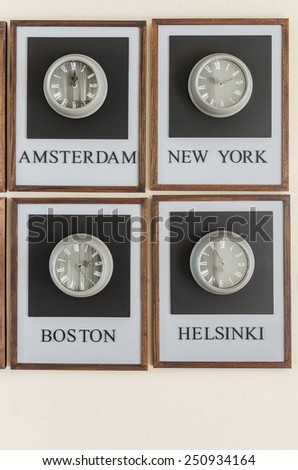 clock different time zones on the wall - stock photo