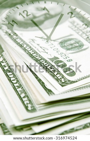 Clock face and American banknotes - stock photo