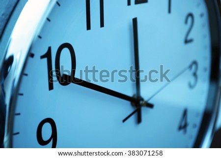 Clock face in blue light closeup - stock photo