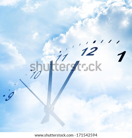 Clock face in blue sky - stock photo
