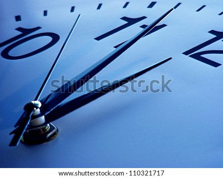 Clock face in blue tone. Time concept.
