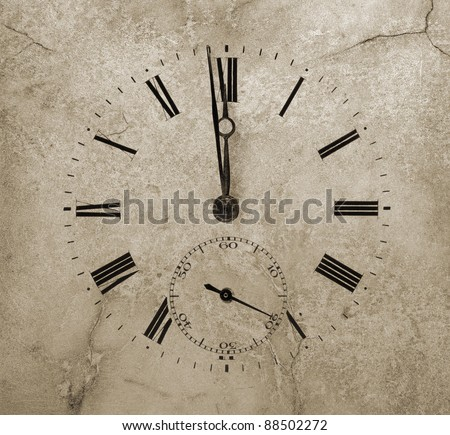 Clock face on a cracked stone. One minute to twelve. - stock photo