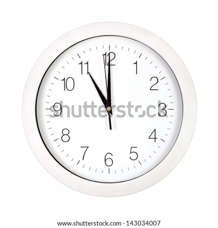 Clock face showing eleven o'clock isolated on white