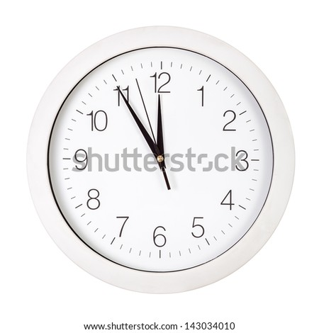Clock face showing five minutes to twelve isolated on white - stock photo