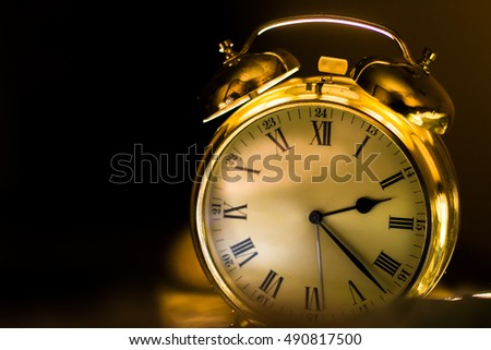 clock. gold watch at night