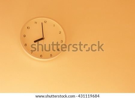 clock hanging at the wall  - stock photo